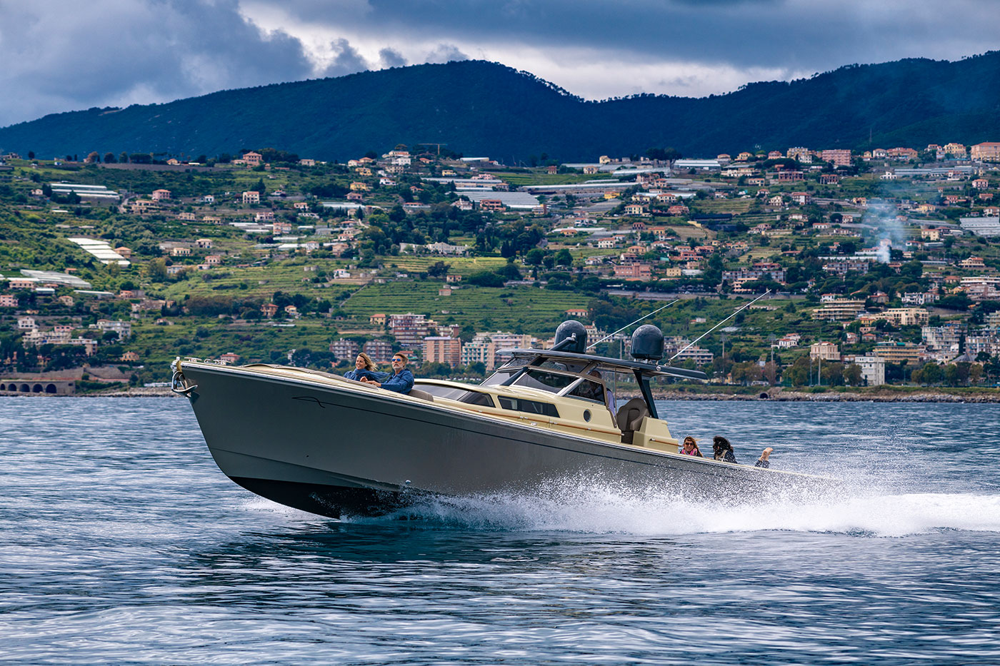Photo of Runabout 43 by the coast with Italian town in the background